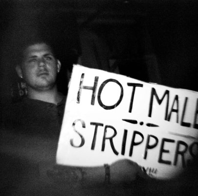 Sign Holding Guy on Bourbon Street - Diana F+